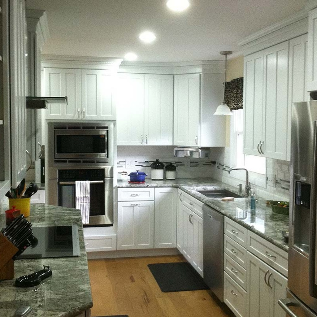 New kitchen construction with white kraftmaid cabinets for Shaker style kitchen cabinets white